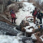 dive team preparing to search icy stream
