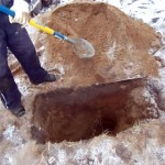 digging out a piece of unexploded ordnance