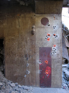 blasting holes for explosive demolition of Nike missile magazine