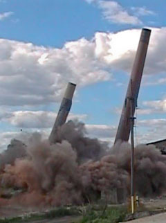explosive demolition of Celotex smokestacks & building