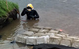 diver assist in bank reconstruction