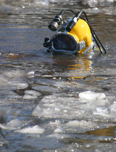diver with helmet-mounted camera in icy Alderwood Lake