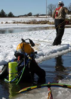 dive team performing underwater survey
