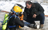 preparing to dive for UXO in frozen lake