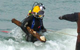 hauling underwater UXO from the surf