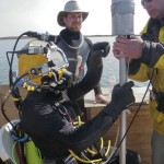 dive team preparing to locate underwater UXO with magnetometer