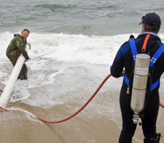 fighting the surf to recover underwater UXO
