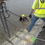 diver assists with placement of concrete mats