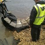 diver assists in positioning concrete revetment mats
