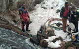 divers preparing to search icy stream