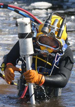 UXO diver with metal detector in Heck Housing™